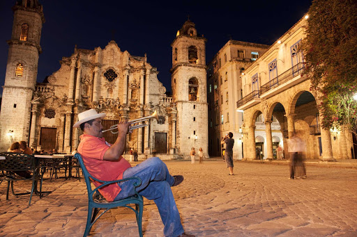 Cuba-Man-Playing-Trumpet-at-Night-in-Front-of-Church.jpg - The Plaza de la Catedral in the center of Old Havana offers opportunities to hear local musicians.