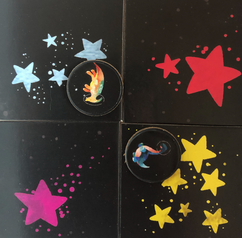 Closeup shot of constellation tiles and their dinosaurs.