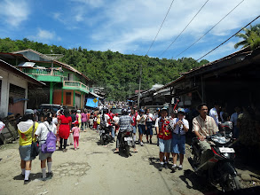 Photo: People abounding as we traveled through many villages on our journey to Teluk Dalam. Sunday August 17th was Indonesian Independence day and people were out everywhere celebrating.