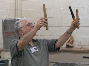 Photo: Stuart shows three nostepinnes (yarn winders) in different woods, brought by Pat Taylor.