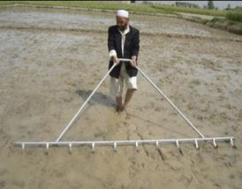 Photo: Ghulam Hazrat, a DAIL staff member in Doshi, practices marking. [Photo by Ali Muhammad Ramzi]