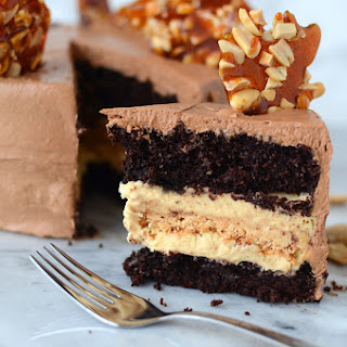 Chocolate & Peanut Cake with Caramel Peanut Butter Nougat Filling & Chocolate French Buttercream Frosting.
