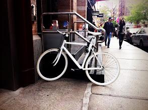 Photo: White Bike on Black