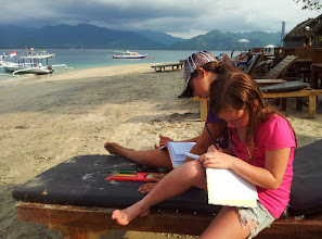 Photo: journalling on the beach