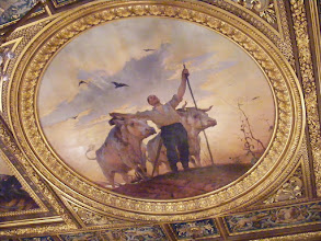Photo: On the ceiling and above the doors, the artist, Georges Bertrand, has depicted scenes of country life as well as the work in the fields.