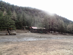 Photo: The main cabin and our water spicket in near view.
