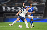 Harry Kane of Tottenham Hotspur holds off Ben White of Brighton