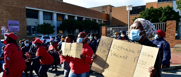 Workers picket outside Livingstone Hospital during a visit by union leaders on Friday