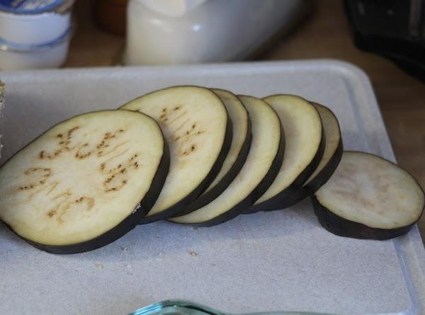 Wash & dry eggplant. Slice eggplant into 1/2 inch slices. Put aside.