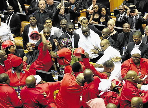 Security officers and EFF MPs scuffle during the State of the Nation address.