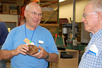 Photo: Bob Browning shares a smile while talking about his walnut bowl.