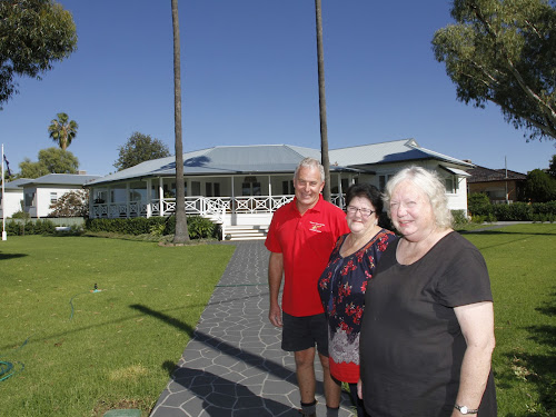 COME TO THE FAIR: Narrabri Volunteer Support Group president Allan Goode with committee members Judy Jansson and Di Harris at the venue for the Autumn Fair, Jocellin Jansson's McClintock Street garden.