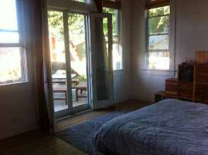 Photo: The french doors with narrow transom light above. All doors and windows in the next section of the house, including the kitchen, are Andersen. The light and breeze in this bedroom is amazing. The french doors open onto a 350 sq ft deck, that also has an entry into the kitchen.