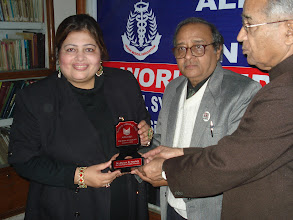 Photo: Dr. Afshan N Hashmi receiving 'Ibn Sina Public Health Award' from Dr. V. K. Jain and Prof. Syed Zillur Rahman