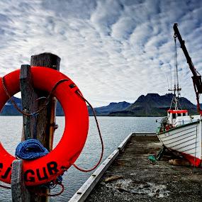 Circles Lifebuoy by Þorsteinn Ásgeirsson - Transportation Boats ( boating, mountains, iceland, icerock, a dock, pwc79, sea, cloud formation, circle, lifebuoy, fishing boat, gjögur )