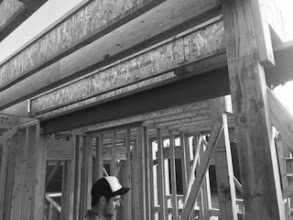 Photo: Not sure why the black and white, but this picture from Burke shows a metal beam (the blackest thing in the middle of the shot), on top of which our second floor will be built. This is a VERY STRONG house.