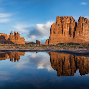 Morning Reflections by Phyllis Plotkin - Landscapes Caves & Formations ( clouds, arches national park, rock formations, reflections, sunrise, landscape, pond )