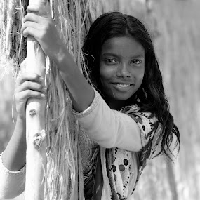 Innocent Smile.. by Sofia Zaman - People Portraits of Women ( bamboo, girl, nature, black and white, smile )