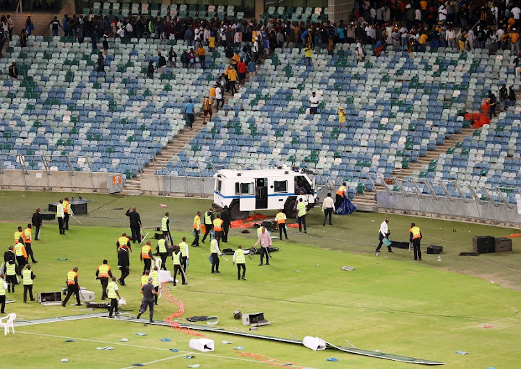 Fans vandalising the stadium during the 2018 Nedbank Cup match between Kaizer Chiefs and Free State Stars at Moses Mabhida Stadium, Durban on 21 April 2018.