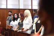 FILE PHOTO: Nan Lee ( blonde) waits in court to see the man accused of abducting and killing her daughter Siam Lee.