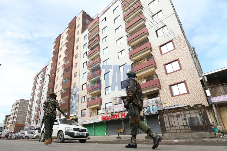 Police officers patrol the streets of Eastleigh Estate in Nairobi.