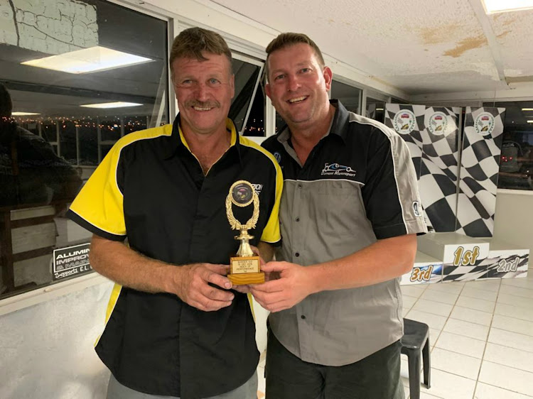 Eastern Cape racers Dean Ball and Philip Weise show off their index of performance trophy they won at the Border 100 Endurance race in East London at the weekend.