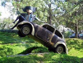 "Photo: ""La Guatemalita"" on an upended VW. A sculpture byEfraín Recinoson the grounds of Hotel Santo Domingo del Cerro in Antigua."