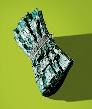 """Photo: JUDITH LEIBER """"Becca"""" emerald python clutch. $3,995. Also available in black Lurex® with crystals. $2,995. Italy. Python clutch not available in California. Main Floor. 212 872 2872"""