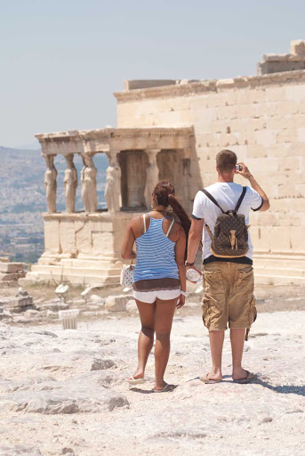 Visitors observe the Porch of the Caryatids on the Acropolis in Athens during a Lindblad Expeditions walking tour.