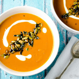 Spicy Harissa and Roasted Butternut Squash Soup with Toasted Pumpkin Seeds and Crispy Mint Leaves.