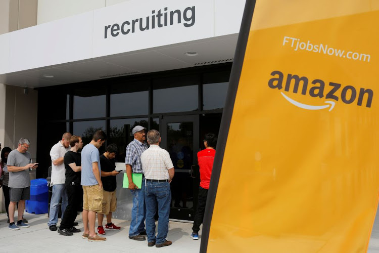 "Job seekers line up to apply during ""Amazon Jobs Day,"" a job fair at the Amazon.com Fulfillment Center in Fall River, Massachusetts, US, on August 2 2017."
