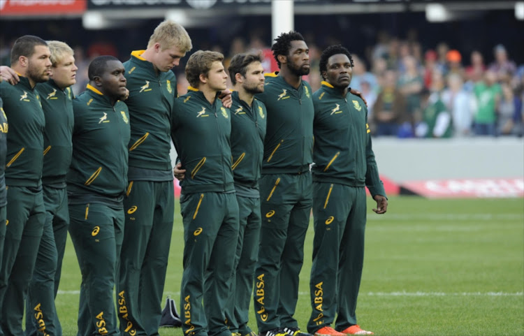 Marcel van der Merwe, Adriaan Strauss, Trevor Nyakane, Pieter-Steph du Toit, Pat Lambie, Cobus Reinach, Siya Kolisi and Lwazi Mvovo line up for the singing of the South African national anthem prior The Castle Lager Rugby Championship 2015 match between South Africa and Argentina at Growthpoint Kings Park on August 08, 2015 in Durban, South Africa.