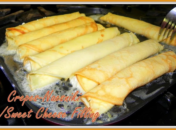 Sprinkle crepes with powdered sugar and serve. You can add some fresh sliced fruit,...