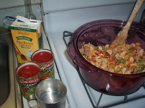 Add rice; saute 2 minutes, stirring constantly. Add thyme, black pepper, and red pepper;...