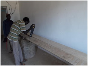 Photo: Constructing shelves for storing supplies at the Wunlang Clinic.