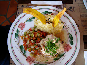 Photo: This dish is stacked seabass with sides of homemade salsa, mashed potatoes, and plantain chips.
