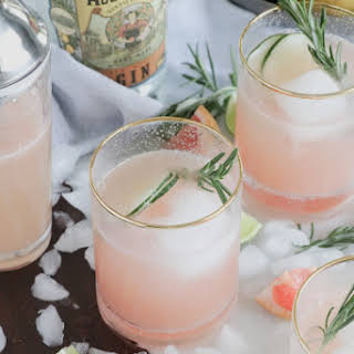 Grapefruit Gin Fizz Cocktail with Rosemary Garnish.