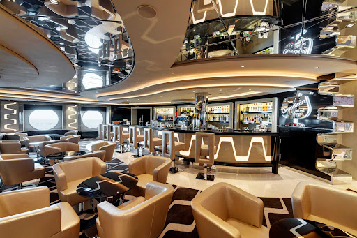 Do some people watching and relax with a cocktail at the Grandiosa Lounge on MSC Grandiosa.