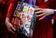 A sex worker holds a bag with condoms. File picture.