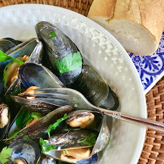 Steamed Mussels in Lemony Garlic Broth.