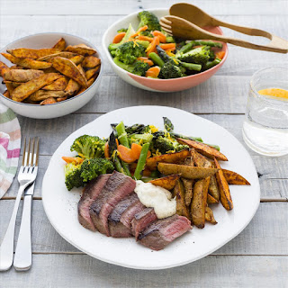 Steaks with Kumara Wedges and Vegetable Toss.
