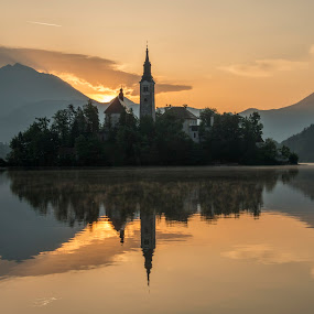 Peaceful Sunrise at Lake Bled by Aleš Krivec - Landscapes Mountains & Hills ( water, reflection, europe, church, beautiful, white, forest, lake, architecture, spring, reflecting, island, mountains, tree, nature, fog, bled, castle, mist )