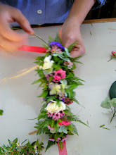 Photo: continue with the tying.  Having a good mix of small flowers, large flowers and greens would jump start your chance of having a good haku lei.