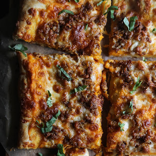 Sausage & Smoked Mozzarella Pizza with Sweet Potato Bechamel