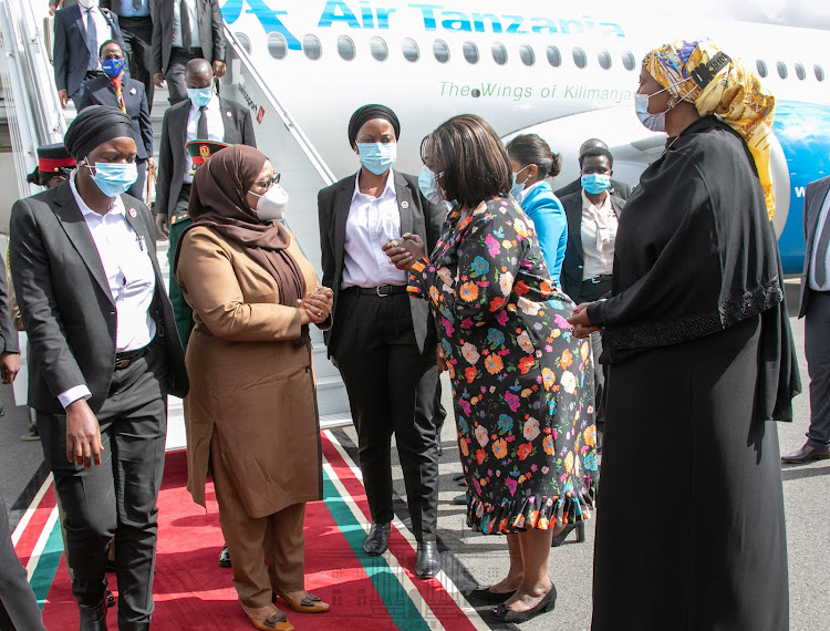 President Samia Suluhu of Tanzania being received by the Kenyan Foreign CS Raychelle Omamo and Sports CS Ambassador Amina Mohamed at JKIA on Tuesday.