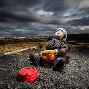The truth is out there by Sigurður Brynjarsson - Babies & Children Children Candids ( look, grass, play, horizon, rock, house, young, spade, shock, up, child, grunge, bucked, stunned, shovel, dramatic, dark, cloud, beam, day, baby, ufo, light, boy )