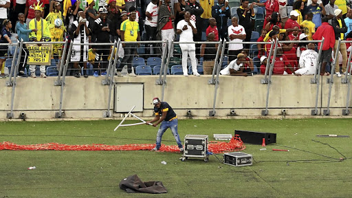 A fan vandalises broadcasters' equipment during a match between Kaizer Chiefs and Free State Stars at Moses Mabhida Stadium in Durban in April.