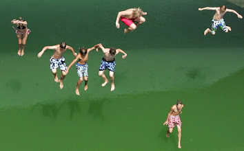 Photo: Youngsters jump from a bridge to cool off in the waters of the Isar river canal in Munich, southern Germany, Wednesday, July 18, 2007, as the hot weather continued all over Germany. (AP Photo/Diether Endlicher)