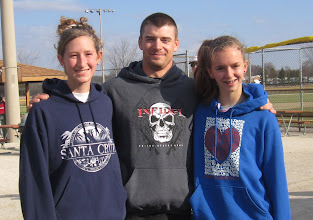 Photo: Elliott Turnbaugh with two beautiful young ladies who are friends of the family