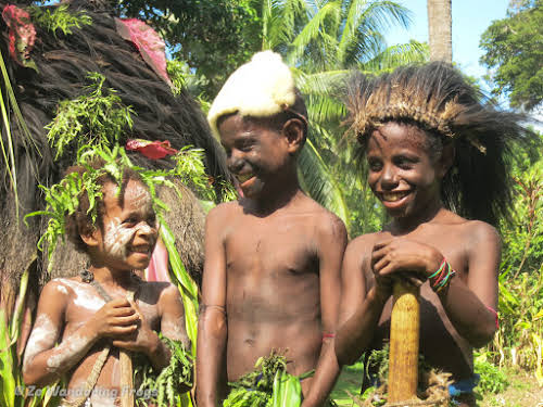 Papua. New Guinea East Sepik River Clans Crocodile Traditions. Kids from the Cassowary Dance